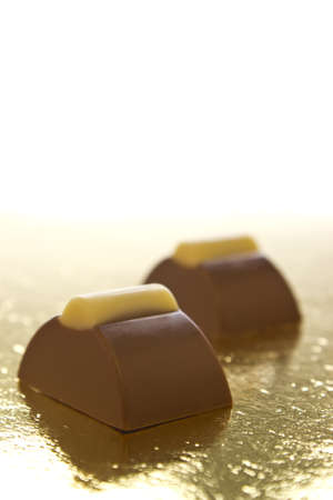 two chocolate bonbons on a white background. Stock Photo