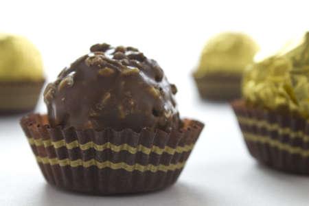 Close up of a hazelnut chocolate ball on a white background