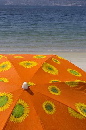 Close up of a sun beach umbrella on the seashore in sunny day.