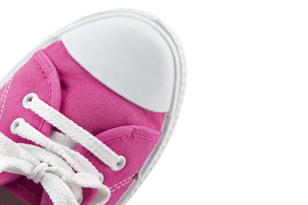 Close up of a pink sneakers on white background. Stock Photo