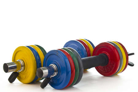 get a workout: Picture of a colorful dumbbell set on white background. Stock Photo