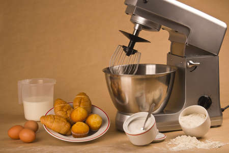 Picture of a mixer and all the ingredients to cook muffins.