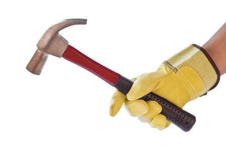 Photograph of a mans hand with a safety glove holding a hammer on a white background. Stock Photo