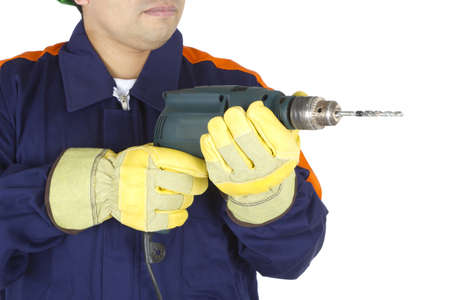 Picture of the hands of a worker holding a drill on a white background.