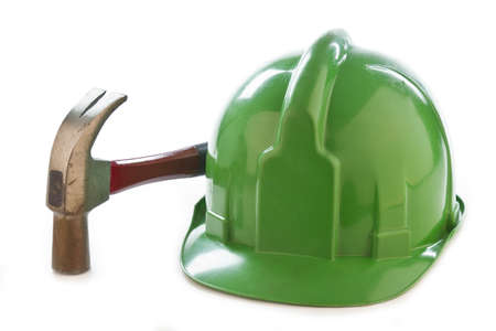 Photo of a helmet and a hammer on a white background.