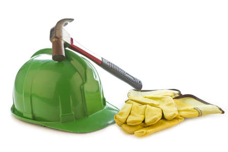 Picture of a helmet, safety gloves and hammer on a white background. Stock Photo