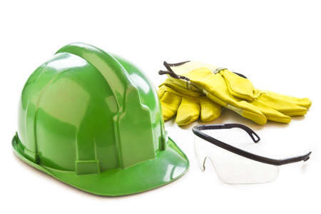 Picture of a helmet, gloves and safety glasses on a white background.