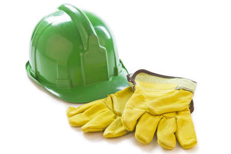 Photography of a safety gloves and a helmet on a white background. Stock Photo