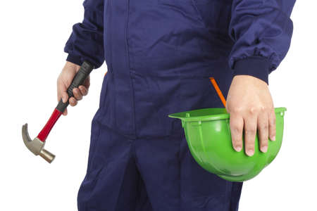 Picture of a worker holding a helmet and hammer on a white background. Stock Photo