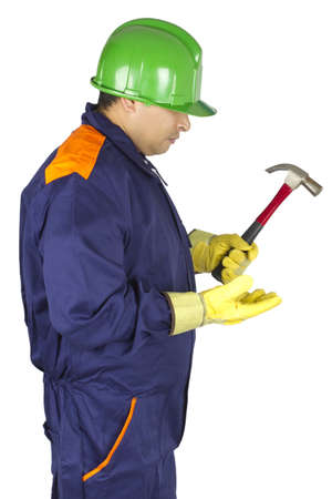Picture of a worker looking at his hammer on a white background.