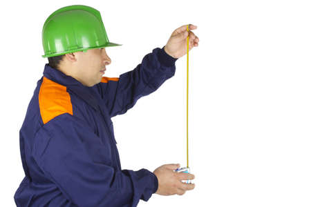 Picture of a worker making a measurement on a white background. Stock Photo