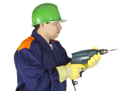 Picture of a worker using a drill on a white background. Stock Photo