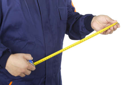 Picture of a worker taking a tape measure on a white background.