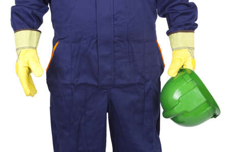 Photograph of a worker with his helmet on a white background. photo