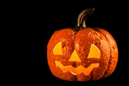 Picture of a Halloween pumpkin made of ceramics on a black background. Stock Photo