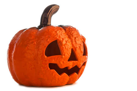 Picture of a Halloween pumpkin made of ceramics on a white background.