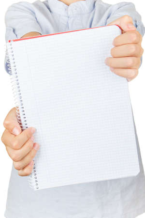 Child on a white background showing his notebook to the camera. Stock Photo