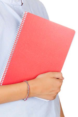 Student holding a red notebook on a white background. Stock Photo