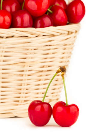Close up to a fresh and juicy red cherries in a basket.