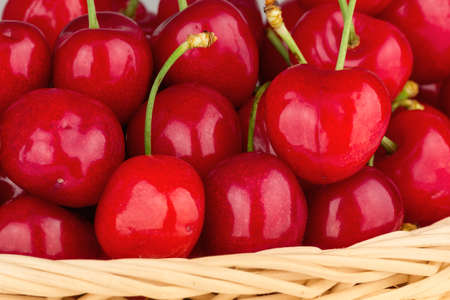 Close up to a delicious, fresh and juicy red cherries in a basket.