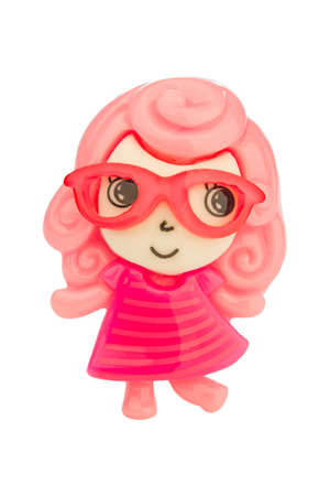 Little doll with glasses, hair and pink dress isolated on a white background. Stock Photo