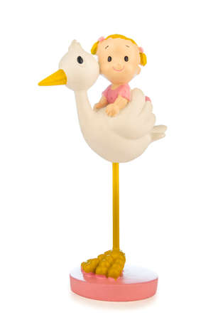 Figure of a little girl on a stork isolated on a white background.