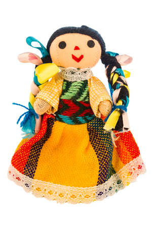 Rag doll with a typical dress of Mexico isolated on a white background. Stock Photo