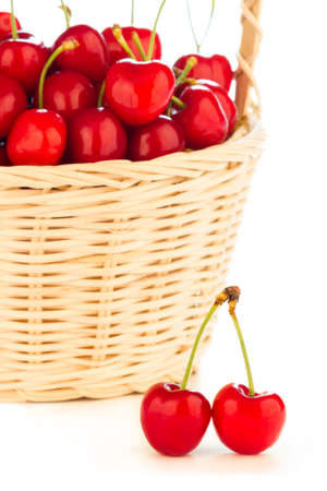 Delicious, fresh and juicy red cherries in a basket.