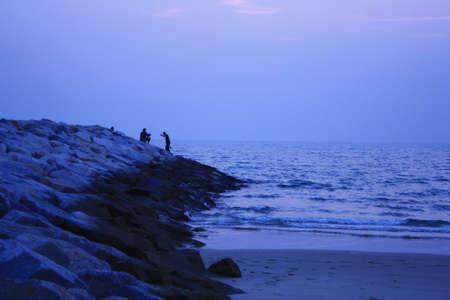 Fishing after sunset at Sangjun beach Rayong Thailand Stock Photo