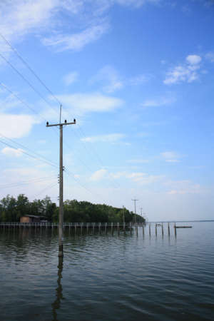 electricity post on the water
