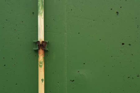 PVC pipe on the green wall of left side