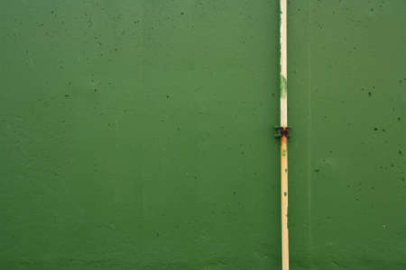 PVC pipe on the green wall of right side