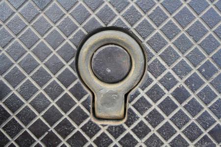 hook on the manhole Stock Photo