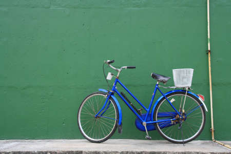 the bicycle parking front of green wall