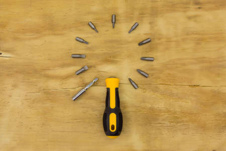 top view of screw driver on wood background