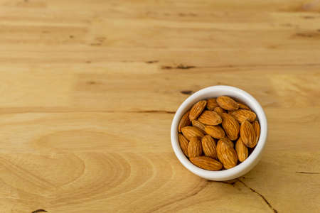 almond nuts in wooden background Stock Photo
