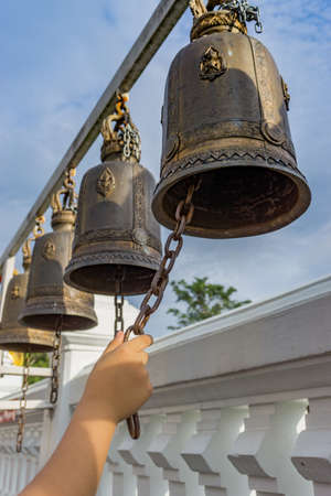 handle ringing a bell in a Buddhist temple Stok Fotoğraf
