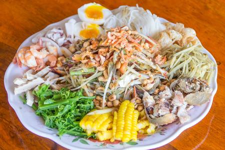 papaya salad with horse crab , shrimps and  squids and more photo