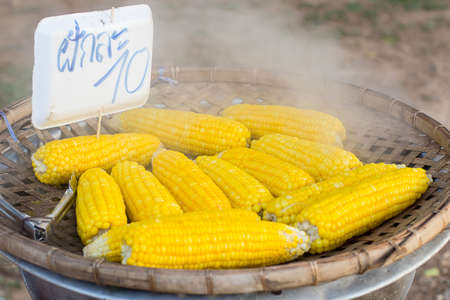 emanating: Hot corn and steam emanating with Price label