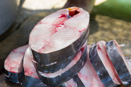 dissection: pieces of king mackerel fish after dissection