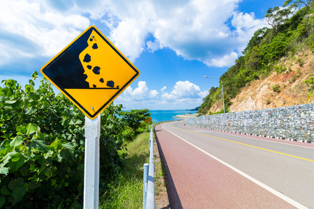 Beware of falling rock sign in Thailand road