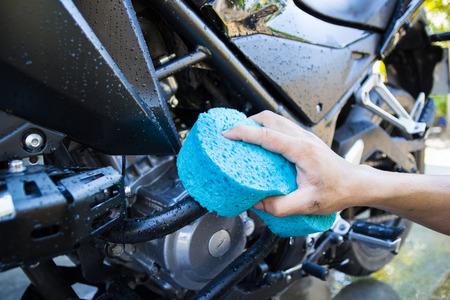 washing black motorcycle