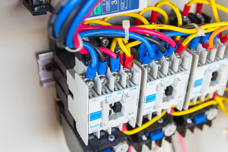 breakers: Close up circuit breakers and wire in control panel