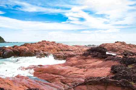 Pink stone (Arkose) near the beach , Waves hit the pink stone , Pink stone viewpoint , CHANTHABURI THAILAND Stock Photo