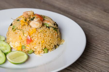 Shrimp fried rice on wood floor with space for text