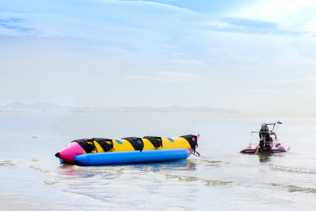 banana boat with speed boat parked at the beach ,East of  Thailand