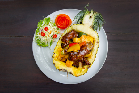 pork rip baked with pineapple on white plate Stock Photo