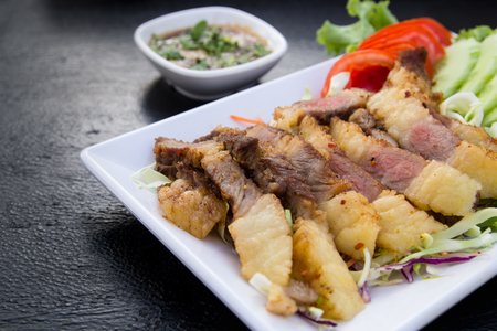 Grilled beef steak sliced with source , Thai Food
