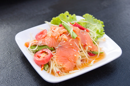 Delicious spicy papaya salad with fresh salmon