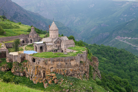 tatev: Armenian landscape of Tatev monastery complex surrounded by green mountains
